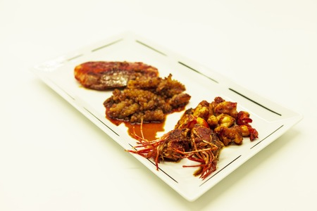 langoustine: Fried tiger prawns and octopus in a Chinese style grilled barbecue in a spicy oil