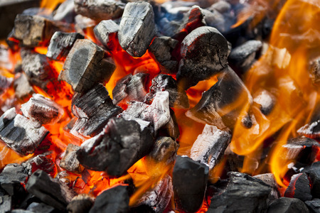 flare up: The fire, burning coals close up