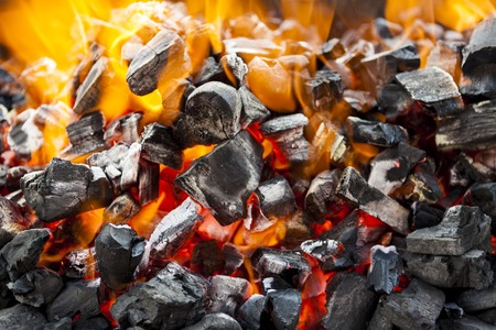 The fire, burning coals close up