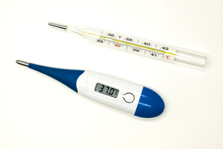 old mercury: Old mercury medical thermometer and modern electronic thermometer closeup on white background.