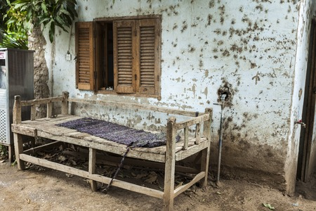 rickety: Rickety old bench made of wood in the village in Africa.