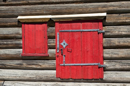 excellent background: Red old door and window on the wooden wall of a village house. Excellent background Stock Photo