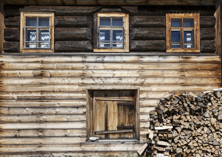 excellent background: Old door and window on the wooden wall of a village house. Excellent background