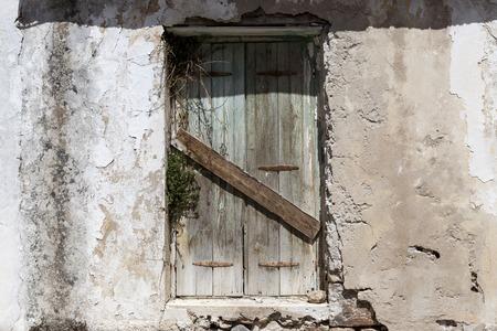 excellent background: Old door in the stone walls of the village houses. Excellent background