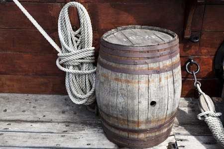 intricate: Older intricate marine ropes and old wooden barrel on deck of a ship. Stock Photo
