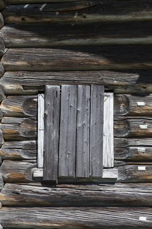 abandoned farmhouse abandoned farmhouse: Old window hammered wooden planks of a wooden house, an abandoned farmhouse Russia. Disruption in the village, the abandoned settlements