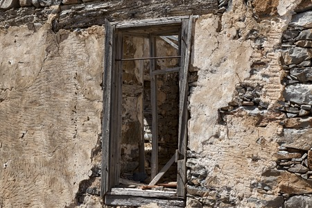 firmness: The ruins, the ruins of the destroyed castle fortress wall with a window with iron bars. The wall of the old prison window with bars on the escape of criminals
