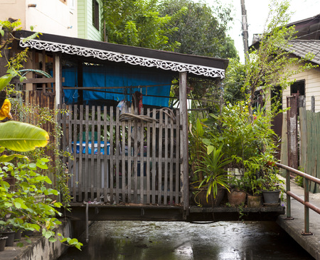 The old hut, shacks houses stand on stilts in the water on the waterfront. Houses of poor people. Thailand Bangkok