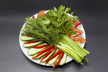 Fresh salad from the farm vegetables. Chopped onion, tomato, cucumber, parsley, cilantro, dill. Eco products without GMF. Products without Genetically Modified Foods.