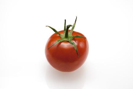 Fresh juicy fruit Sicilian varieties Sungold of tomato closeup on white background Stock Photo