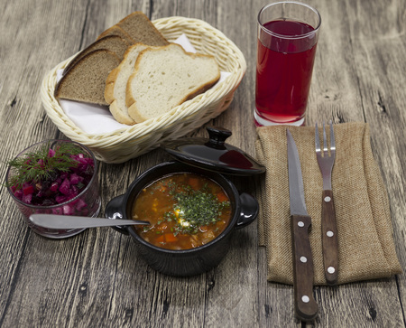 Rustic lunch of tomato soup with beef, beet salad on the table Stock Photo