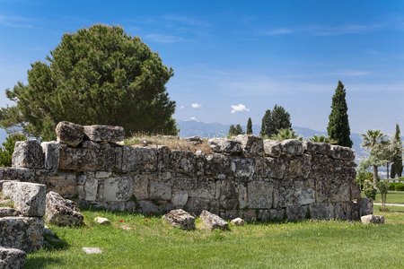 Beautiful background with ancient ruins and Sunny summer day. The old ruined walls of the ancient city