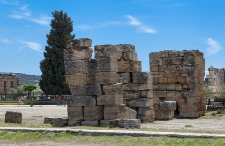 The elements of the wall of a ruined ancient house. Beautiful background of the ruins of Greek cities Stock Photo