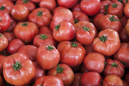 Qualitative background from tomatoes. Fresh tomatoes. Red tomatoes. Village market organic tomatoes Stock Photo