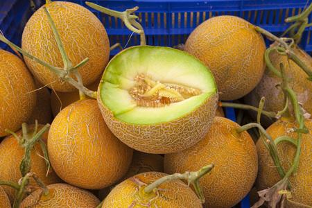 Juicy ripe melons close up at the village market Stock Photo