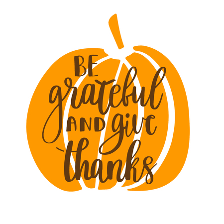 Be grateful and give thanks. Gratitude hand lettering quote and orange pumpkin isolated on white background. Handwritten thankfulness phrase Stock Photo
