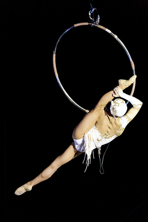 Girl gymnast in the circus. Aerial ring. Russian Circus. . Aerial gymnast