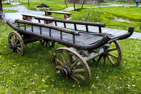 Gypsy cart. Old cart on green grass in the back of the house on summer day Stock Photo
