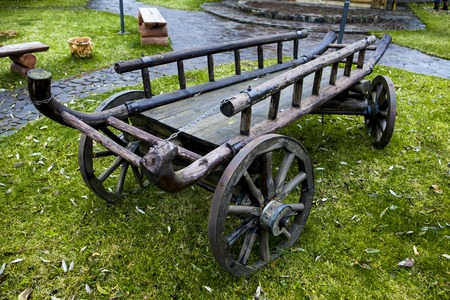 Cart. Old cart on green grass in the back of the house on summer day Stock Photo