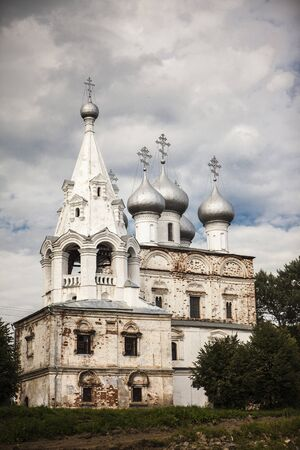 Russian Christian church, a temple on a background of gray sky and clouds