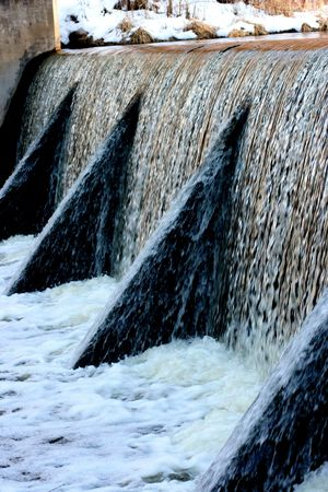 meltdown: A fast slowing dam during spring meltdown. Stock Photo