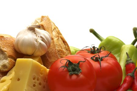 Background of fresh vegetables, garlic, french baguette and cheese in rustic style