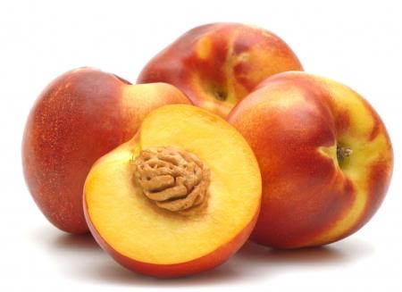 Four fresh nectarines on white background