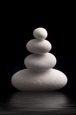 white pebbles on black background