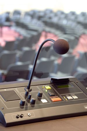 interpretation: Microphone and switchboard in interpretors booth of a conference booth Stock Photo