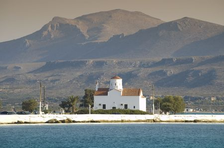 herbage: View over antique white church on the island and mountain background Stock Photo