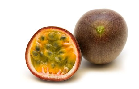 two fresh passionfruits on white background Stock Photo - 3458529