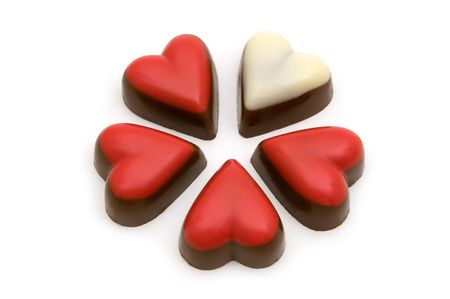 fancy sweet box: Chocolate red and white hearts on white background