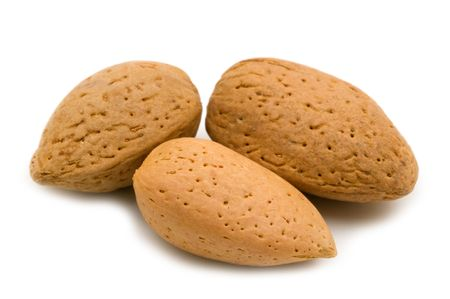 nutshells: Almonds on white background