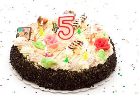 Torta de cumpleaños 5 años con velas y purpurina  Foto de archivo - 3596911