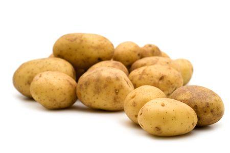 白い背景の上に新鮮なジャガイモ 写真素材