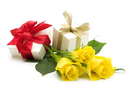 yellow roses and gift boxes on white background photo
