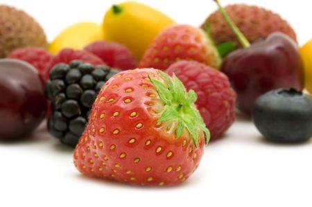 苺と白い背景の上の果物 写真素材