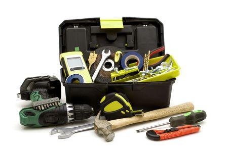 プラスチック道具箱と白い背景の上のツール 写真素材