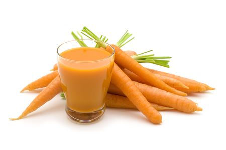 fresh carrots juice on white background photo