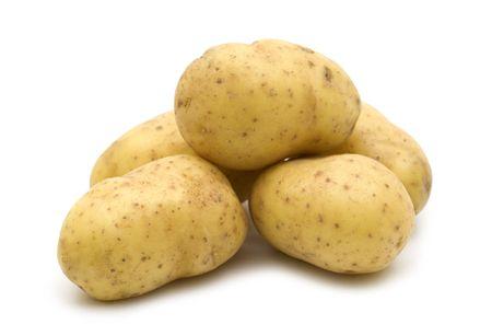 raw potatoes on white background