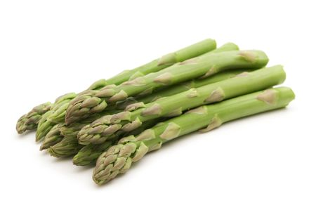comestible: fresh asparagus on white background