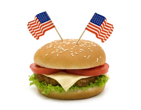 Tasty hamburger with two flags on white background