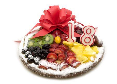 fruits cake with candle on white background photo