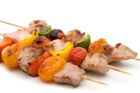 meat skewers:  grilled pork kebabs on white background Stock Photo