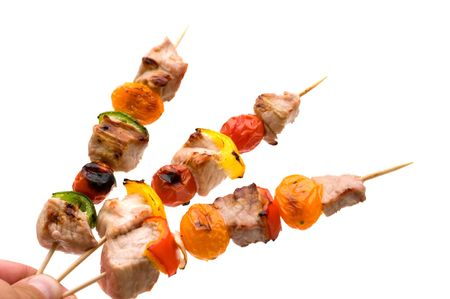grilled pork kebab in the hand Stock Photo