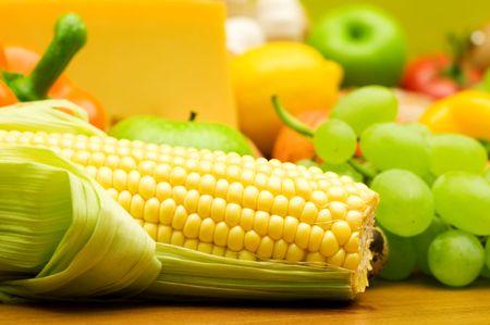 fresh corn on fruits background Foto de archivo