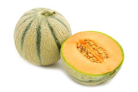 マスクメロン: 白い背景の上にオレンジ色のメロン 写真素材