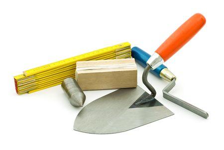 fixer: mason working tools on white background Stock Photo