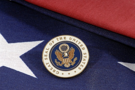 A Great Seal of the U S  on a folded American Flag  photo