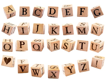 A set of rustic alphabet blocks, 26 letters, a heart shape and an exclamation point, each presented in a different orientation, as if they were falling   Isolated on white  photo